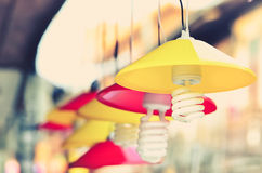 Vintage color filter for yellow and red hanging lamps Royalty Free Stock Photography