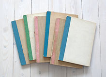Vintage color notebooks on white wooden background. Old vintage color notebooks on white wooden background stock illustration