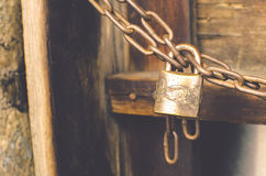 Vintage color for Old rusted lock with rusted chain Stock Photos