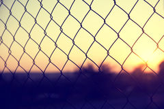 Vintage color outside rusty wire fence with sunset Royalty Free Stock Image