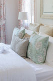 Vintage color pillows on bed in luxury bedroom Royalty Free Stock Photo
