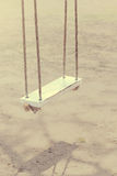 Vintage color of rope swings white wooden. Stock Photo