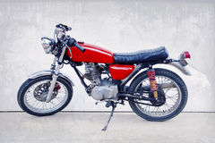 Vintage color style of old classic motorcycle standing against w. Hite background Royalty Free Stock Photography