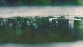 Vintage color tone of close up rain water drop splash falling to royalty free stock images
