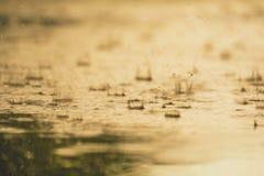 Vintage color tone of close up rain water drop splash falling to stock image