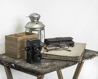 Vintage color tone of retro accessories on the dirty wood table. Stock Photography