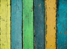 Vintage color wood background textures. Wooden texture in multicolor paint. Color wood background textures.Wood planks painted with paint cracked by a rustic Royalty Free Stock Images