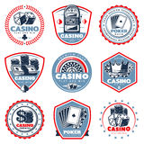 Vintage Colored Casino Labels Set. With slot machine playing cards dices crown roulette coins money chips isolated vector illustration Royalty Free Stock Image