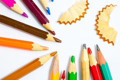 Vintage colored pencils with chips. On white Stock Photography