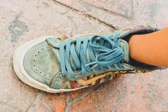 Vintage colored shoe of a teenager royalty free stock photography