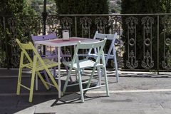 Vintage colored tables and chairs by a cafe Royalty Free Stock Image