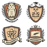 Vintage Colored University Emblems Set. With owl crossed keys atom model feather book on shields isolated vector illustration Stock Photos