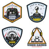Vintage Colored Video Game Emblems Set. With joystick portable controller steering wheel arrow buttons headphones isolated vector illustration Royalty Free Stock Images