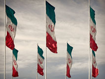 Vintage Colored Waving Iranian Flags royalty free stock photography