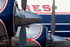 Vintage Colorful DC-7 Propeller Airplane Stock Photography