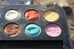 Retro old vintage photo of pallette make up , 60s 70s fashion, blue, white, bright macro close up. Vintage colorful eye shadow from 70s, 60s grandma collection stock photos