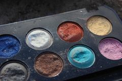 Retro old vintage photo of pallette make up , 60s 70s fashion, blue, white, bright macro close up. Vintage colorful eye shadow from 70s, 60s grandma collection royalty free stock photo