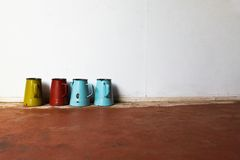 Vintage colorful jar. Four vintage colorful jars on the floor Stock Photography