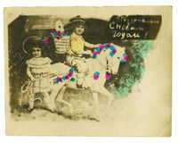Vintage colorful photo of a young beauty couple. On horses Stock Image