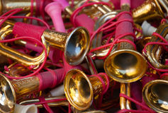 Vintage colorful toy trumpets at flea market. Stock Photos