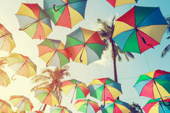 Vintage colorful umbrella on side beach - festival party in summer, Royalty Free Stock Images