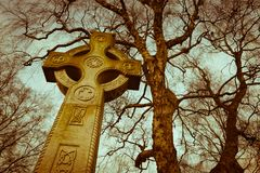 Vintage coloured Celtic cross gravestone Royalty Free Stock Photos