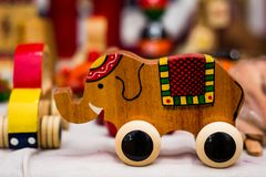 Vintage colourful old wooden elephant toy on wheels.  royalty free stock photo