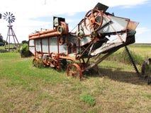 Vintage combine at Tomkins Saskatchewan. A Vintage combine at Tompkins Saskatchewan Stock Images