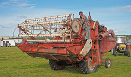 Vintage combined harvester at Roseisle Rally. Early combined harvester driving round the ring at Roseisle  Vintage Rally held on 23rd September 2012 Stock Photos