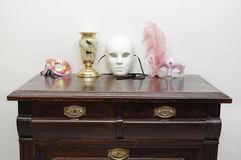 Vintage commode with masks Royalty Free Stock Photos
