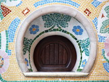 Vintage Communication Window. Vintage round communication/ ticket window decorated with mosaic in Barcelona, Spain Stock Photo