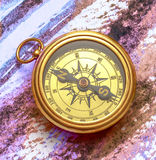Vintage compass on abstract watercolor painting Royalty Free Stock Photo