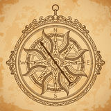 Vintage compass on aged paper background. Royalty Free Stock Photo