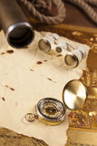 Vintage compass and binoculars on letter stock images