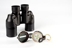 Vintage compass and binoculars for travel on a white background royalty free stock images