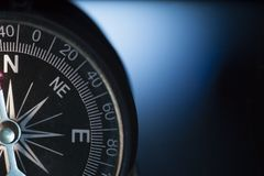 Vintage compass in blue background.  Stock Image