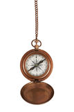 Vintage compass on a chain. In brass body Royalty Free Stock Photo
