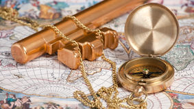 Vintage compass with chain on a map. Vintage compass with chain  on the old map Royalty Free Stock Photography