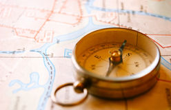 Vintage Compass for Direction Lying on a Map Royalty Free Stock Image