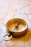 Vintage Compass for Direction Lying on a Map Royalty Free Stock Photography