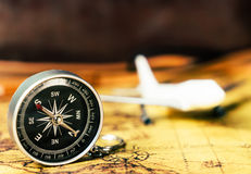 Vintage Compass direction with plane on antique map Stock Images