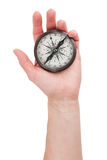 Vintage compass in hand Royalty Free Stock Photos