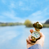 Vintage compass in hand Stock Photos