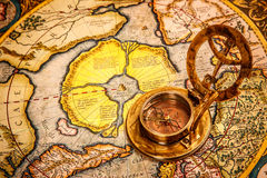 Vintage compass lies on the ancient map of the North Pole (also Royalty Free Stock Images