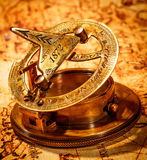 Vintage compass lies on an ancient world map. Stock Images