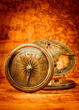 Vintage compass lies on an ancient world map. Royalty Free Stock Images