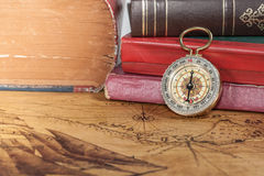 Vintage compass lies on map stock images