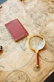 Vintage compass, magnifying glass, pocket watch Stock Images