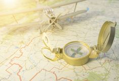 A vintage compass on the map and an airplane. Concept travel. a vintage compass on the map and an airplane in the background. Tourism, vacation stock image