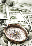 Vintage compass and money Royalty Free Stock Image